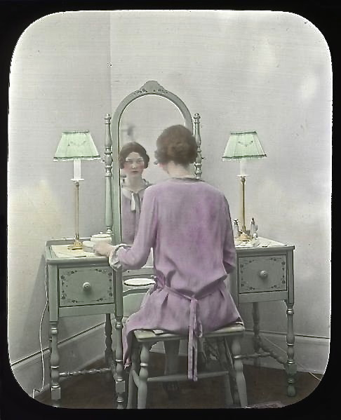 Woman_at_mirror_circa_1930s