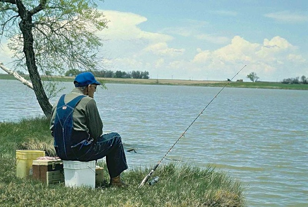 Old_man_fishing Pedro Ramirez_ US Fish and Wildlife Service Public Domain