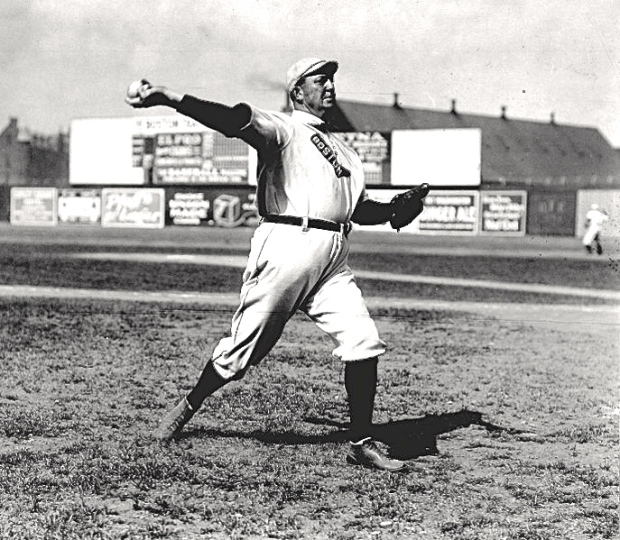 His shoulders well-positioned, his throwing arm fully extended, legendary pitcher Cy Young shows great range of motion as he prepares to release the ball